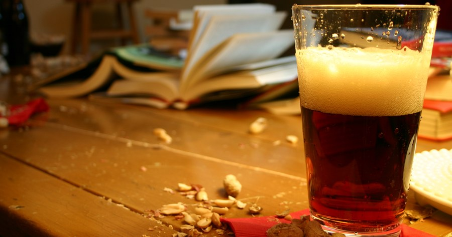 manuscript critique of books, with beer